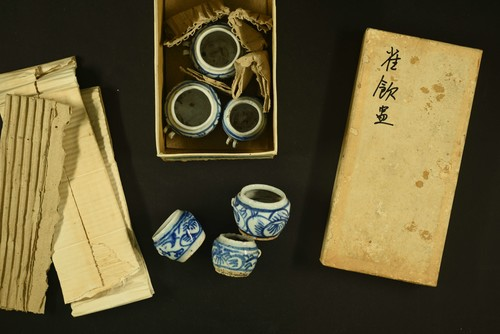 "Image: Flat lays in one of the ""Objects"" boxes. Year unknown. Photo: Chu Hoi Ding."