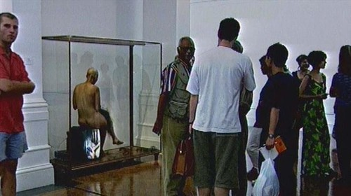 Tracey Rose, 'Span I', with people staring, South African National Gallery, film still, 1997.*