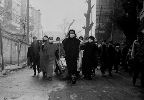 Image: Artists parading along the streets of Lanzhou during <i>Funeral</i>, 1993. Courtesy of Yang Zhichao.