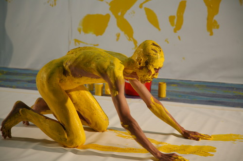 Image: Lee Wen, <i>Anthropometry Revision: Yellow Period (After Yves Klein) #2</i>, Performance at SooBin Art Int'l UBI Warehouse, Singapore, 2008. Courtesy of the artist's estate.