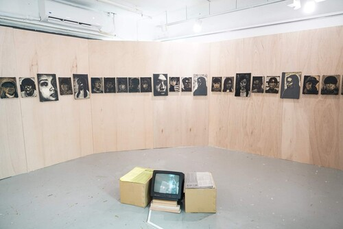 Image: Exhibition view of <i>Woodcut Portraits 2020-2021: This too shall (not) pass</i>, 2021. Courtesy of the artist, Koel Chu, and Hong Kong Open Printshop.