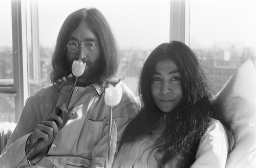 Image: John Lennon and Yoko Ono laying in bed during their Bed-ins for Peace in Amsterdam, by Eric Koch/Anefo, licensed under CC0 1.0.