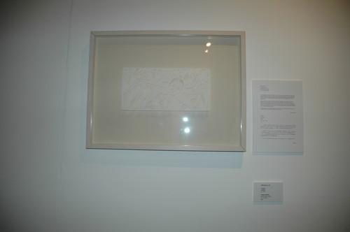 Image: Display of Bovey Lee, <i>Trading Identity</i>, framed paper cutting, 2006. Documentation of <i>Talkover/Handover</i> by Phoebe Wong, 2007.