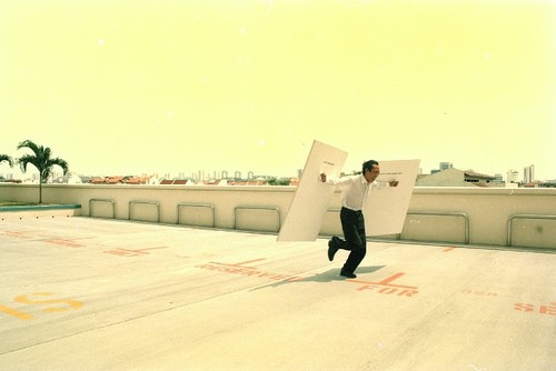 Image: Lee Wen performing <i>Is Art Necessary?</i>, 2004. Courtesy of Lee Wen Archive, Asia Art Archive Collections.
