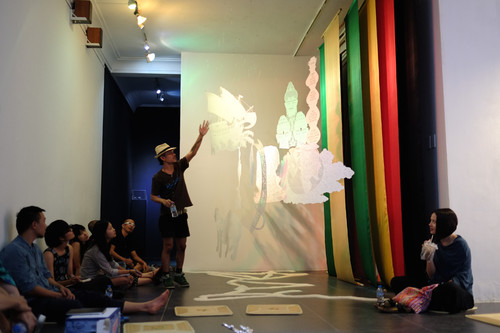 Image: Group critique with local artists and participants of Session 5: